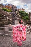 Young lady in a beautiful traditional Japanese costume at Kiyomizu-dera Buddhist Temple. Kyoto, Japan -November 2, 2018: Young lady showing the beauty of her royalty free stock photos
