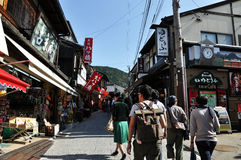KYOTO, JAPAN - OCT 21 2012: Tourists walk on a street leading to Stock Photo