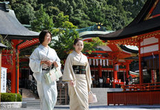 KYOTO, JAPAN - OCT 23 2012: Japanese girls at Fushimi Inari Stock Image