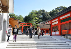 KYOTO, JAPAN - OCT 23 2012: A tourist at Fushimi Inari Shrine Stock Images