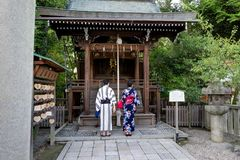 Japanese Couple with Kimono in front of Shrine Praying Stock Images