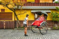 KYOTO, JAPAN - OCTOBER 18, 2016: RICKSHAW RIDE SATISFACTION Stock Photography