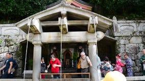 Tourists at the Fushimi Inari-taisha in Kyoto,. Kyoto, Japan: October 17, 2018: Tourists at the Fushimi Inari-taisha in Kyoto, Japan. Fushimi Inari Shrine is a stock video
