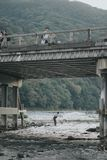 KYOTO, JAPAN, SEPTEMBER 14, 2017: fisherman trying to catch some fish on the river Kamo, Arashiyama , Kyoto. Arashiyama is famous stock images