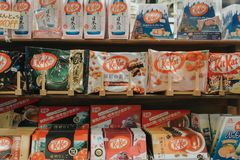 KYOTO, JAPAN, SEPTEMBER 14, 2017: Japanese Sweets Snack in a street shop green tea matcha, sakura-matcha, and chocolate Kit Kat is stock photos