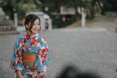 KYOTO, JAPAN, SEPTEMBER 14, 2017: young pretty girl wearing a traditional kimono posing for a picture in kyoto royalty free stock photography