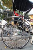 Shiny wheels and spokes of a Japanese rickshaw stock image