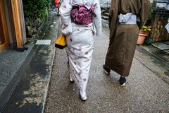 Traditional Japanese couple of kimono from behind Kyoto stock photo