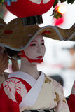KYOTO - JULY 24: Unidentified Maiko girl (or Geiko lady) on parade of hanagasa in Gion Matsuri (Festival) held on July 24 2014 inK. KYOTO - JULY 24: Unidentified Stock Images