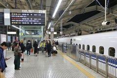 Kyoto station Shinkansen. KYOTO, JAPAN - NOVEMBER 28, 2016: Passengers board Shinkansen train in Kyoto Station, Japan. Shinkansen bullet trains are operated by Stock Image