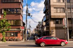 Kyoto street. Japan. Evening. Kyoto street. Red car on the road Royalty Free Stock Image