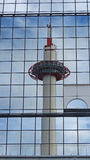 Kyoto tower reflection in glass of Kyoto station Royalty Free Stock Photography