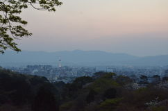 Kyoto town looking from Kiyomizu-dera temple. In the evening.The city is the mountain around Royalty Free Stock Images