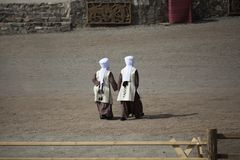 Kyrchyn, Kyrgyzstan, 6th September 2018: Kyrgyz women walking in a countryside during World Nomad Games stock photography