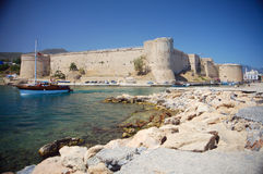 Kyrenia castle. With leaving boat royalty free stock photography