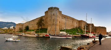 Kyrenia Castle, Girne Kalesi. Kyrenia or Girne is a city at the northern coast of Cyprus, noted for its historic harbour and castle. It is under control of stock photography