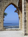 Kyrenia, Cyprus - Bellapais Abbey Arches. Cyprus, Kyrenia - Details of the Bellapais Abbey and view of the Kerynia coast, now in the turkish occupied section of Royalty Free Stock Photography