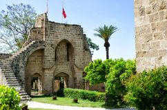 KYRENIA, CYPRUS - May 14, 2014: Ruins of the Abbey of Bellapais in the Northern Cyprus. Bellapais Abbey is the ruin of a. Monastery built by Canons Regular in royalty free stock photography