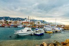 Kyrenia or Girne historical city center, view to marina with many yachts and boats with mountains in the background royalty free stock photography