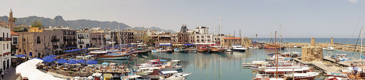 Kyrenia Girne, North Cyprus. Boats and houses at Kyrenia Harbour in Northern Cyprus stock photo