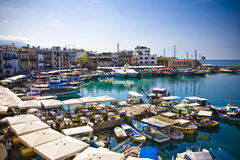 Kyrenia, North Cyprus. Boats and houses and reflections Marina of Kyrenia in Northern Cyprus royalty free stock photo