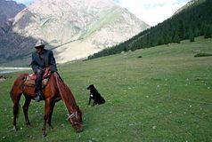 Kyrgyz horseman in Tien Shan mountains Stock Image