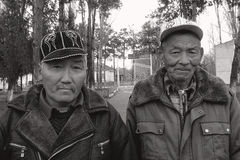 Kyrgyz old mens in caps Stock Images