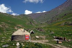 Kyrgyz Yurt. A yurt in Kyrgyzstan, the traditional home of nomadic peoples, selling kymys, a fermented milk drink Royalty Free Stock Images