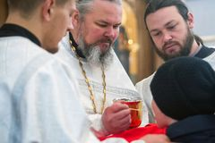 Communion of parishioners in the service of the Orthodox Church. Christmas eve. royalty free stock photos
