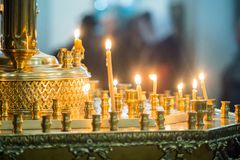Lit candles in the Orthodox Church on Christmas Eve. royalty free stock images