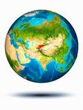 Kyrgyzstan on Earth with white background. Kyrgyzstan in red on model of planet Earth hovering in space. 3D illustration isolated on white background. Elements stock photography