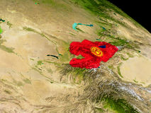 Kyrgyzstan with flag on Earth Stock Photo