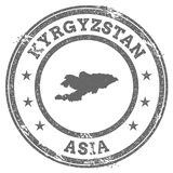 Kyrgyzstan grunge rubber stamp map and text. Stock Images