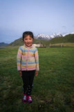 KYRGYZSTAN - JULY 21 2016 Young happy little girl. NARYN PROVINCE, KYRGYZSTAN - JULY 21 2016 Young happy little girl in the back yard of her family`s yurt tent Royalty Free Stock Images