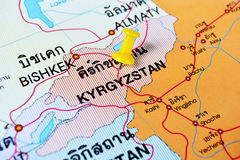 Kyrgyzstan map. Macro shot of kyrgyzstan map with push pin Royalty Free Stock Photography
