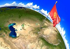 Kyrgyzstan national flag marking the country location on world map. 3D render of the world with the location of the country of Kyrgyzstan marked by its national Stock Photography