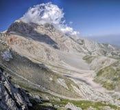 Kyrgyzstan. Picturesque mountain in Kyrgyzstan, with mountain top in cloud Stock Photos