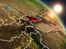 Kyrgyzstan van ruimte tijdens zonsopgang Royalty-vrije Stock Fotografie