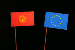 Kyrgyzstani flag with European Union EU flag isolated on black Stock Images