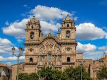 Kyrka av samhället av Jesus på Plaza de Armas i Cusco Peru arkivfoton