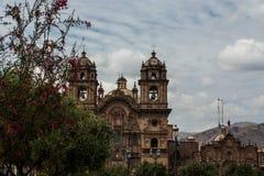 Kyrka av samhället av Jesus i Plaza de Armas i Cusco, Peru royaltyfria bilder
