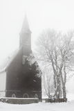 Kyrka i vinter Royaltyfria Bilder