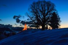 Kyrka på gryning i vinter Fotografering för Bildbyråer
