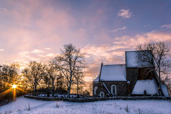 Kyrka. Winter view of the church at sunrise in Gamla Uppsala, Sweden stock photo