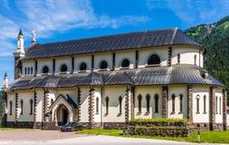 Kyrkan av det välsignade jungfruliga obefläckat grundades på Januari 20, 1866 Falcade by, Belluno, Italien Royaltyfri Fotografi