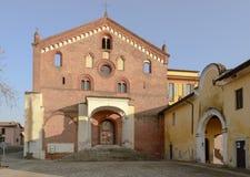 Kyrklig fasad av den Morimondo abbotskloster, Milan, Italien Royaltyfria Foton