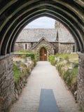 Kyrklig ingång av St Enodoc Royaltyfri Foto