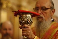 Kyrklig kopp dyrkan Royaltyfria Bilder