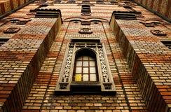 kyrklig vägg för tegelsten Arkivbild