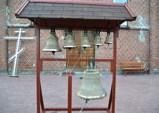 Kyrkliga klockor på en bildlig hopfällbar klockstapel Royaltyfri Bild